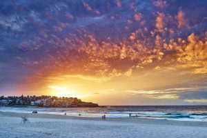 Bondi Beach this morning, colours sprayed over Ben Buckler