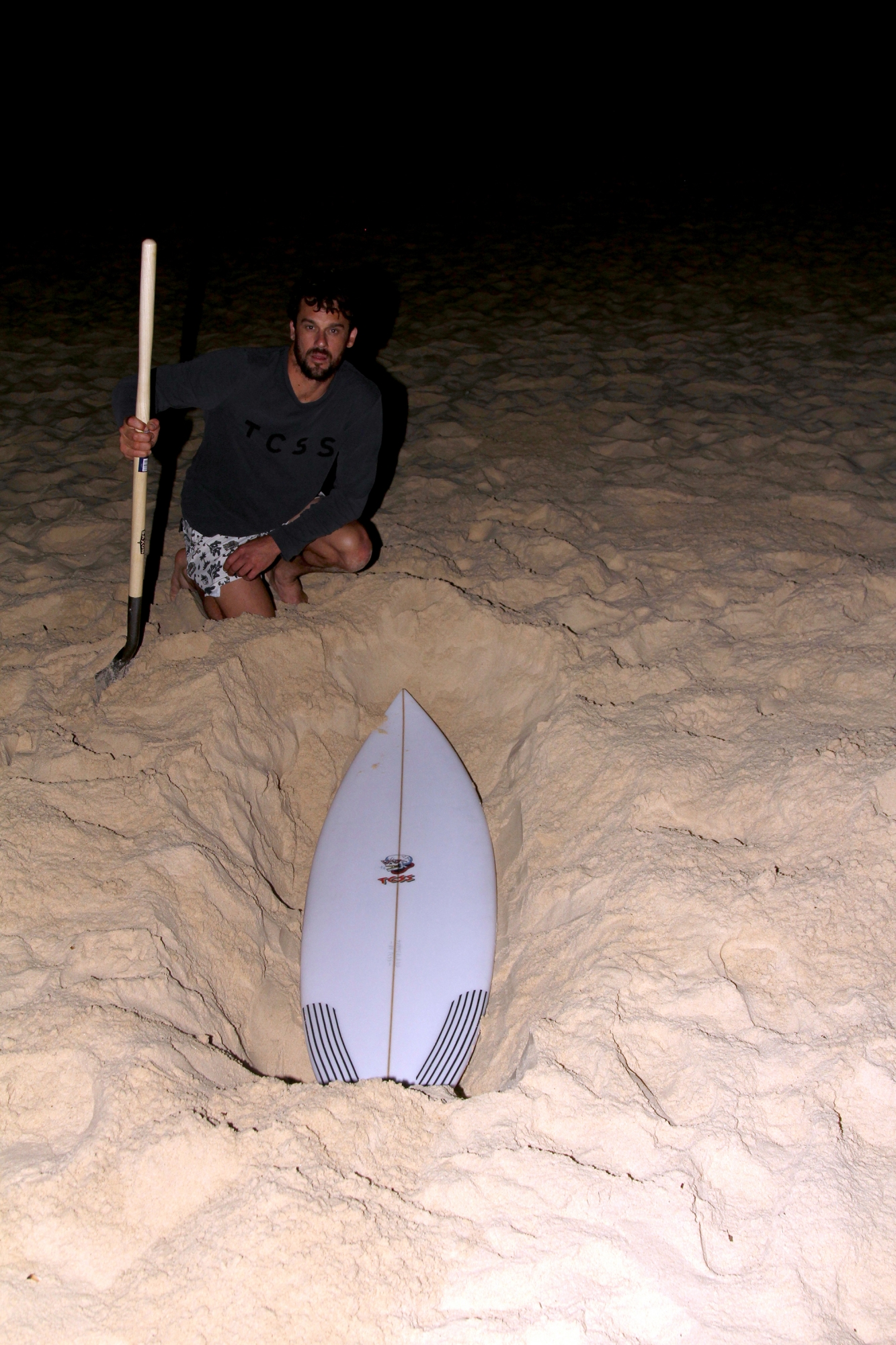 TCSS buried a board in the sands of Bondi Beach, find it - it's all yours