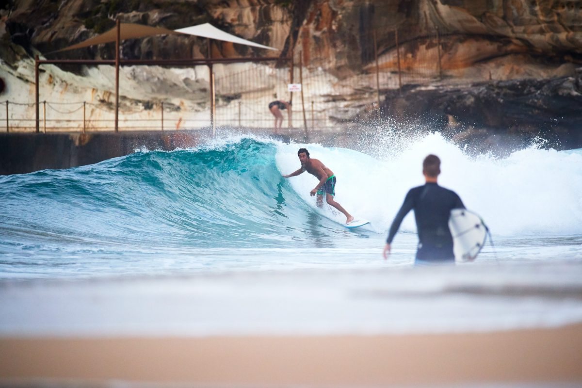 Mickey Malouf, a man grommet, finding the wave of the day at Bondi