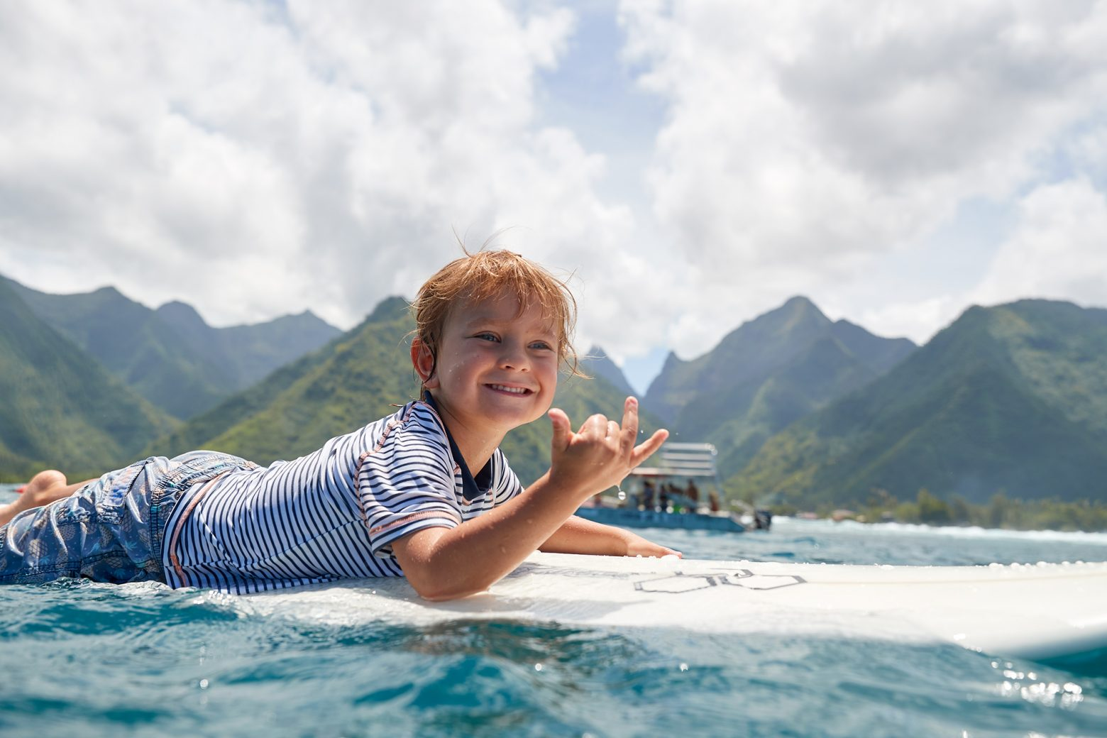 My little one, Spike, insisting to paddle into one at Teahupoo (turned down a tow)