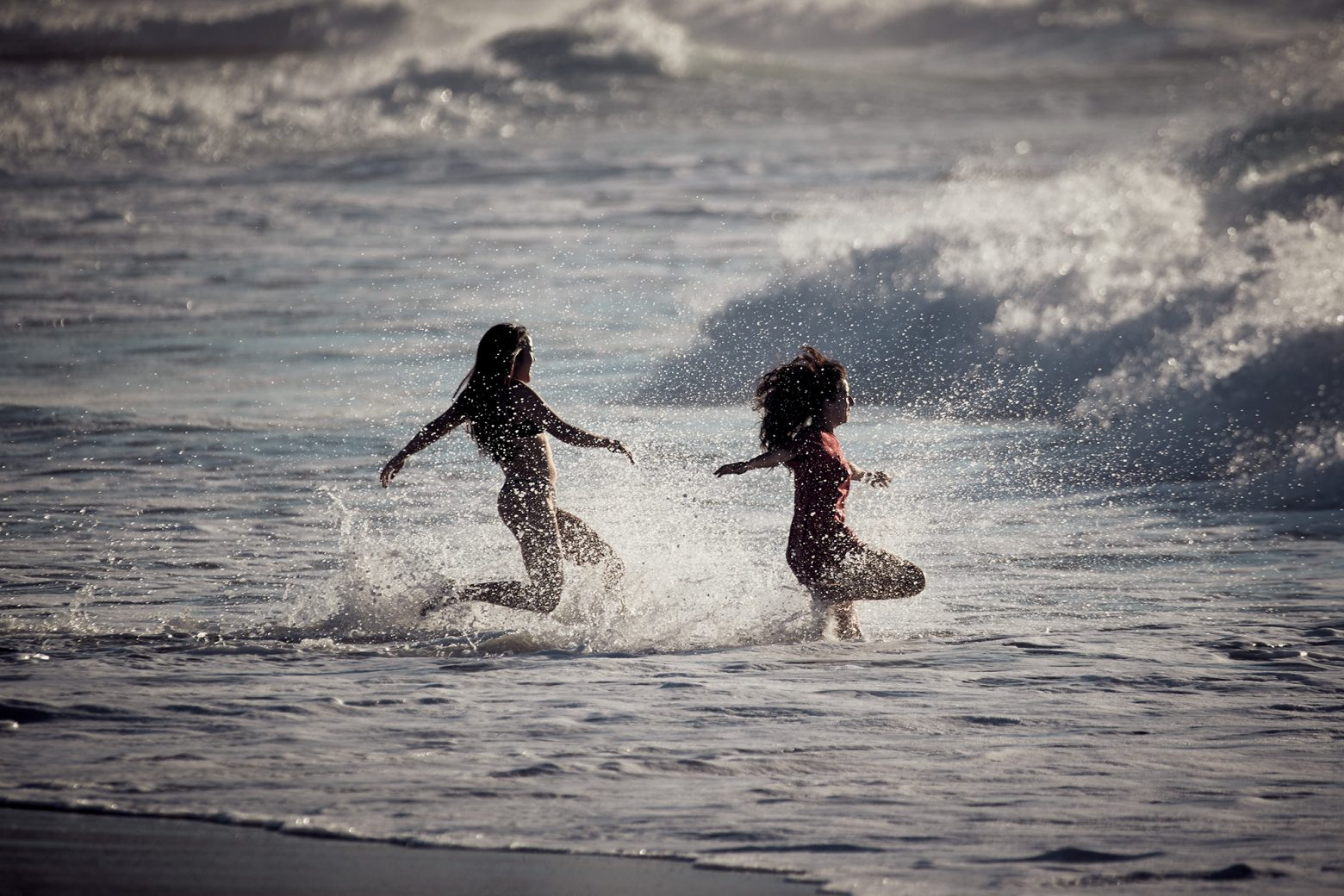 The girls pretty excited about the swell