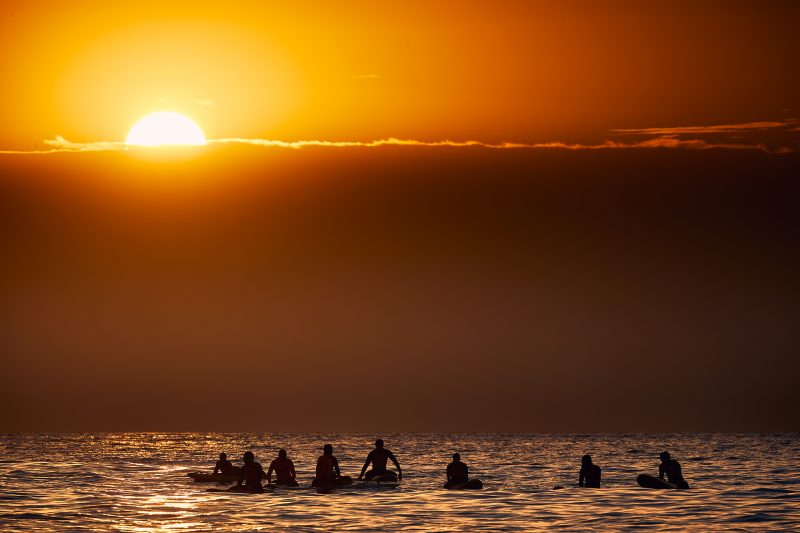 Bronte SLSC board paddlers lighting up at sunrise