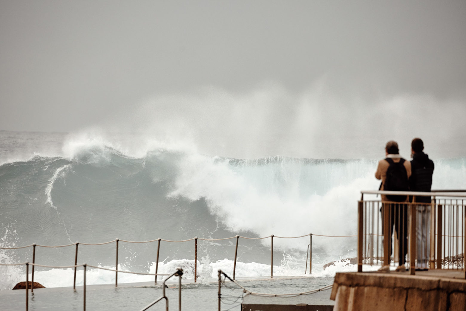 A large chunk smashes against the pool at Bronte