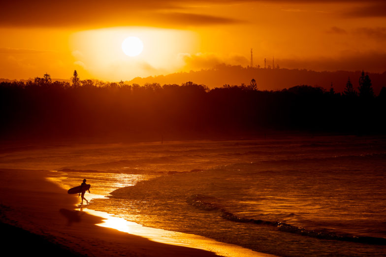 Last surfer out, people surf The Pass dawn to dust