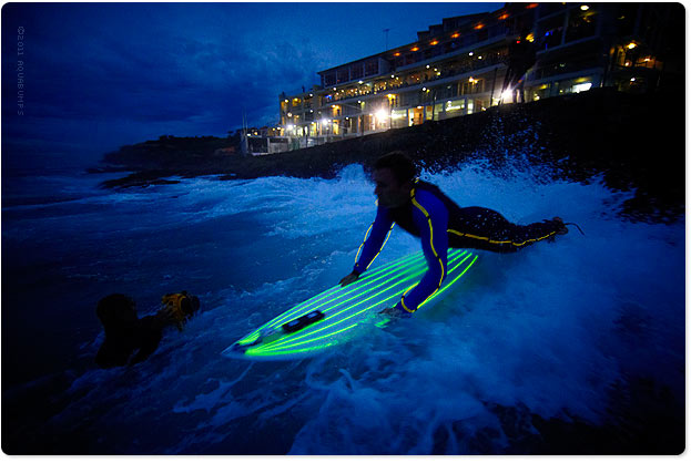 Bondi last night  8pm, Lifeguard Corey Oliver heading out off the Icebergs